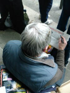 Photo of Gordon doing his puzzle during the rubgy