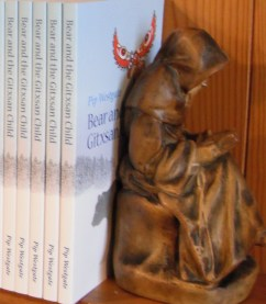 Statuette of man reading a book