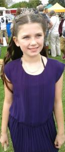 Photo of Laura in purple frock and tiara