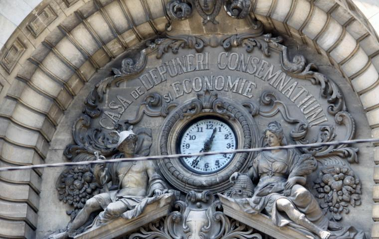 clock surrounded by classical sculpture