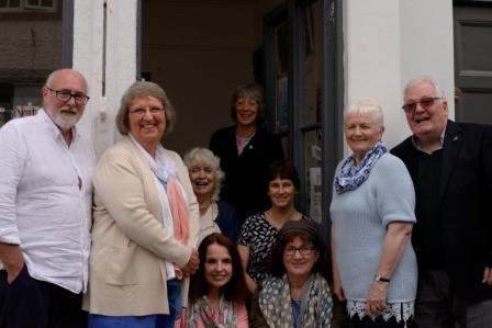 Group shot of authors in doorway of bookshop