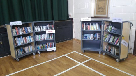 photo of folding bookshelves on wheels