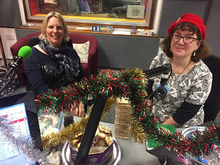 photo of Debbie and Caroline in tinsel-decked recording studio