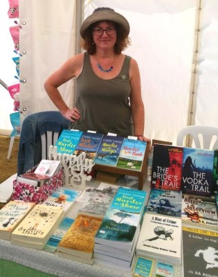 photo of Debbie in hat on bookstall