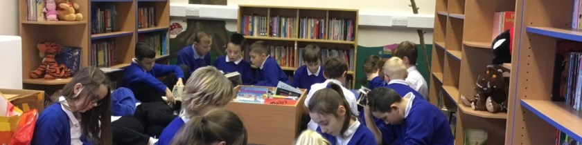 children reading in a school library
