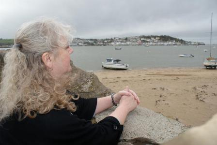 Photo of Helen looking out to sea at Instow harbour