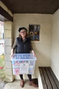 Debbie with box in bus shelter