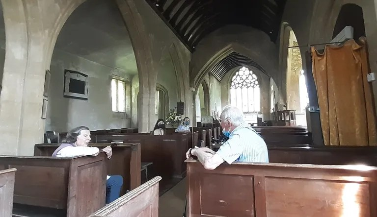 photo inside church of my dad and the churchwarden chatting