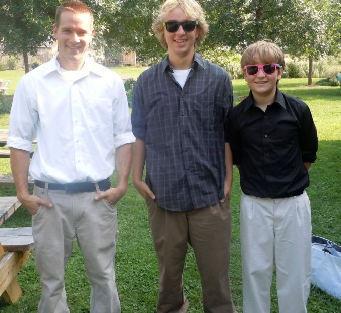 three boys at wedding