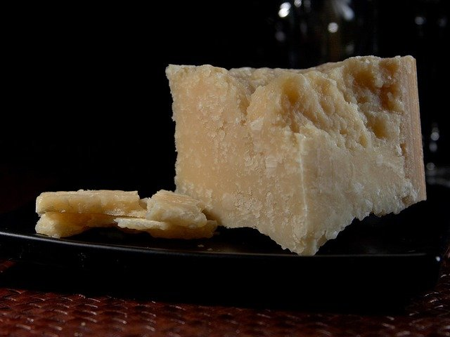 Image by PDPhotos from Pixabay. a wedge of parmesan cheese