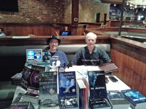 I had to cram all my stuff into a very *small* space, but somehow managed. Pictured with me is David S. Moore, a lovely gentleman who writes sci-fi.