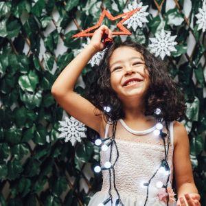 young girl with Christmas lights