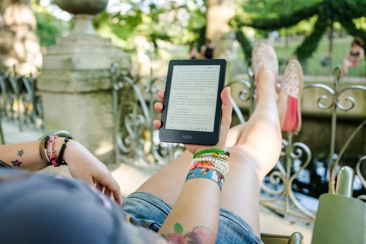 Woman reading ebook in garden