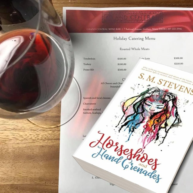red wine glass paperback novel horseshoes and hand grenades