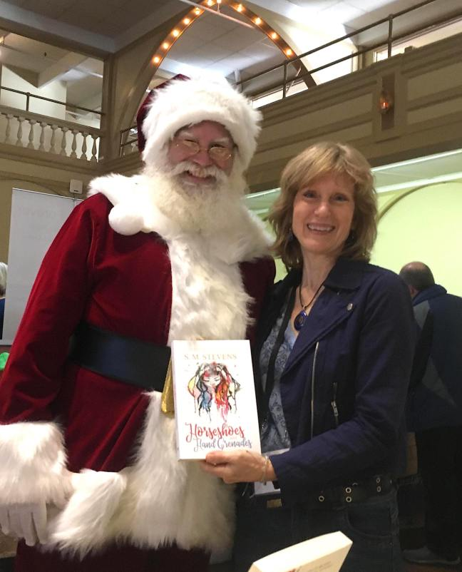 horseshoes and hand grenades author s.m. stevens with Santa Claus