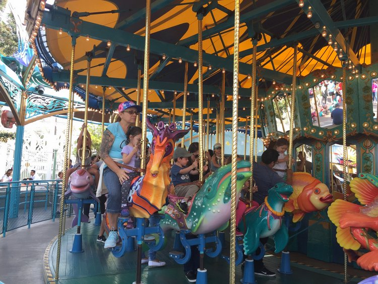 Best Disneyland Spinning Rides for Kids with Autism triton carousel california adventure