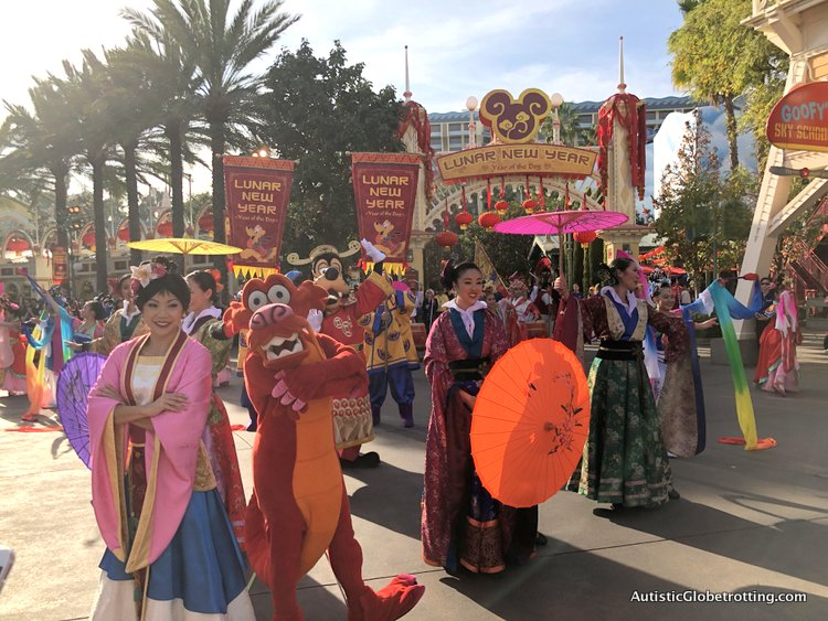 Attending Disneyland's Lunar Year Celebrations with Autism mulan and her ladies dancing at the procession