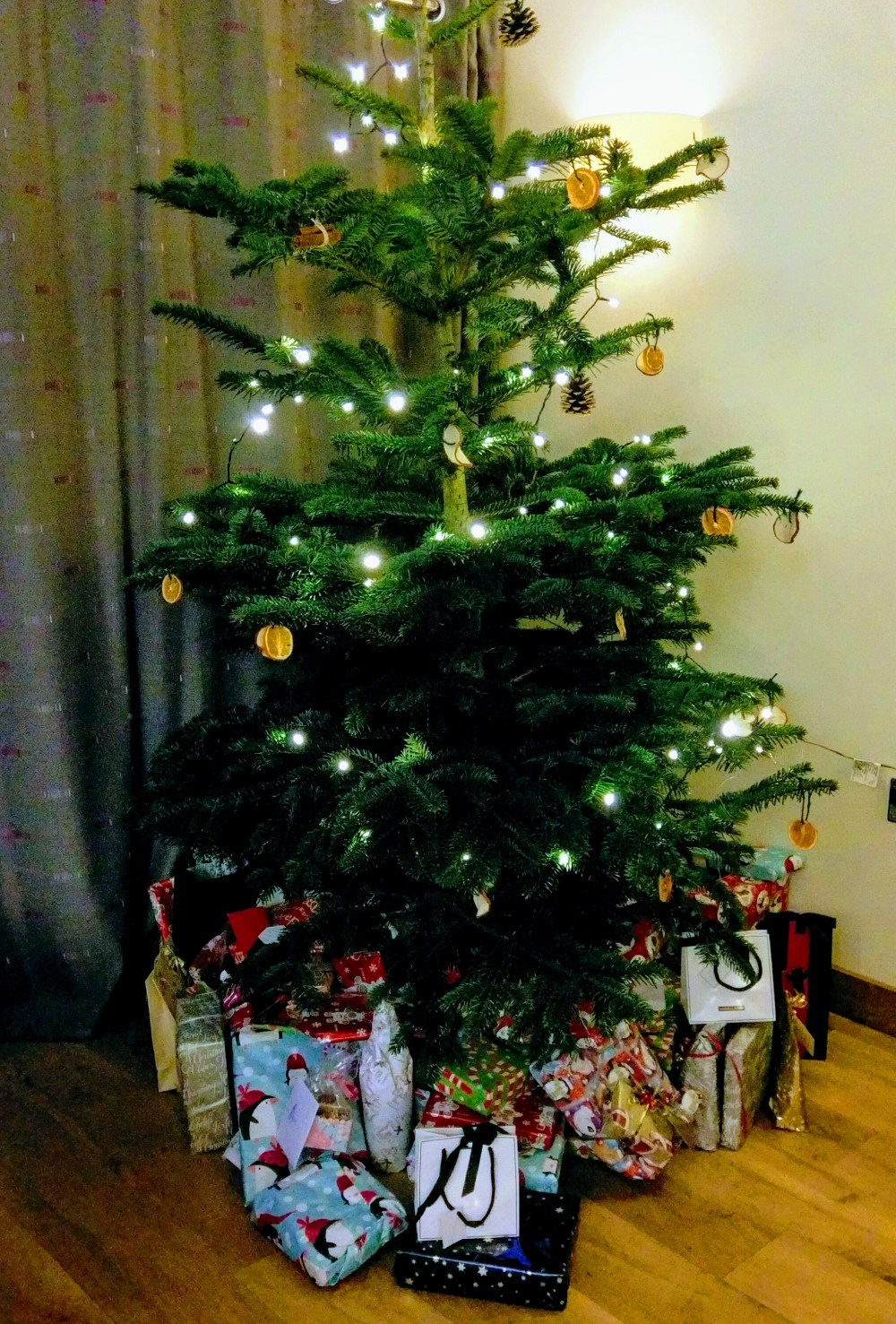A christmas tree with presents beneath