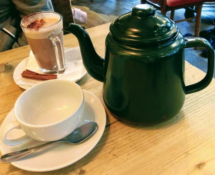 A large tea pot next to a