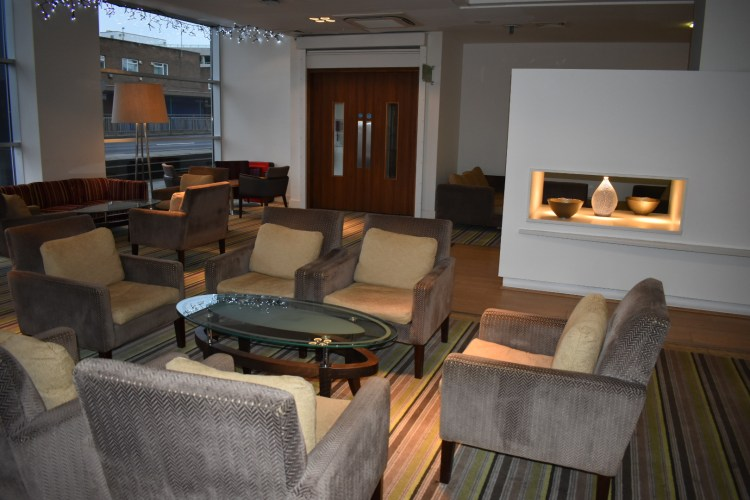 A comfy and large hotel reception seating area
