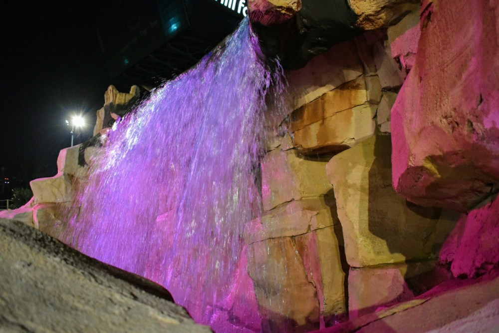 A waterfall, lit up pink