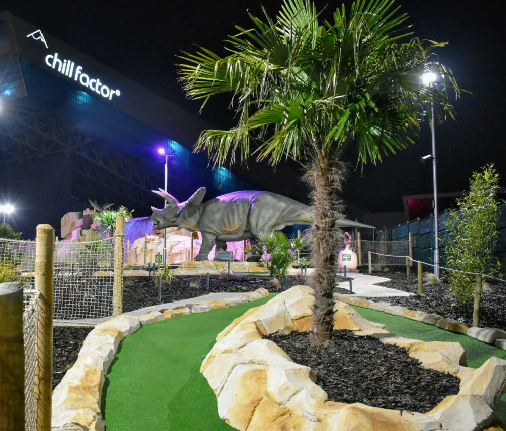 An adventure golf course with dinosaurs