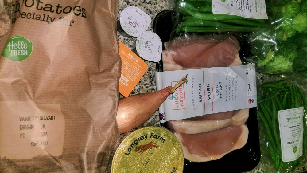 Raw ingredients including pork steaks, challote and vegetables