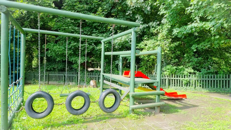 The play area at the Hanging Gate pub in chapel-en-le-firth with obstacle course, tyres and slide.