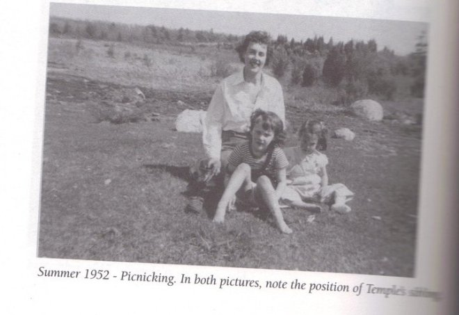 temple-grandin-aged-5-sitting-in-her-mothers-lap-at-a-picnic-with-her-sister-in-the-background
