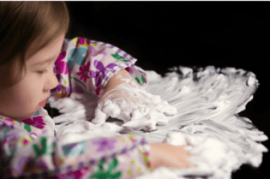 child playing with shaving cream