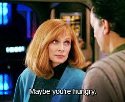 "Dr. Crusher suggesting to Q, ""Maybe you're hungry"""