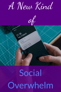 "Two hands holding a black smartphone showing two notifications with a green table and black keyboard in the background.  White and blue text on purple background on top and bottom reads ""A New Kind of Social Overwhelm"""