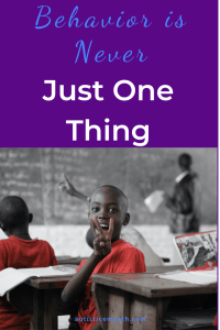 """Several boys wearing red shirts in a classroom. One boy is turned away from the teacher at the blackboard, grinning and flashing a peace sign at the camera. Blue and white text on a purple background reads: """"Behavior is Never Just One Thing"""""""