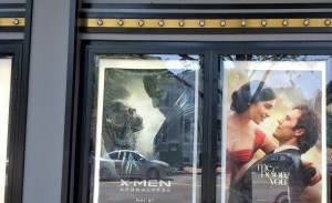 The image is a poster for Me Before You beside a poster for another film