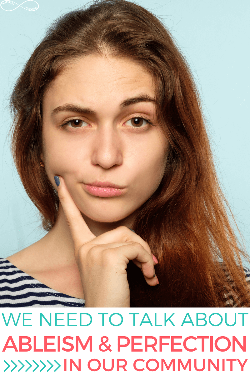 Woman with brown hair faces the camera in front of a blank blue background. She has an eyebrow raised and a finger on the right side of her face. Text reads: We need to Talk About Ableism & Perfection in Our Community.