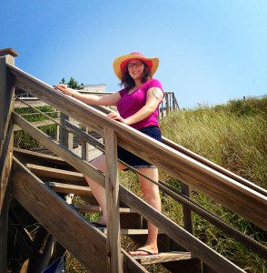 Rachel smiles at the camera, she is wearing a fantastic sun hat