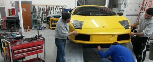 Auto Dent Care working on lamborghini