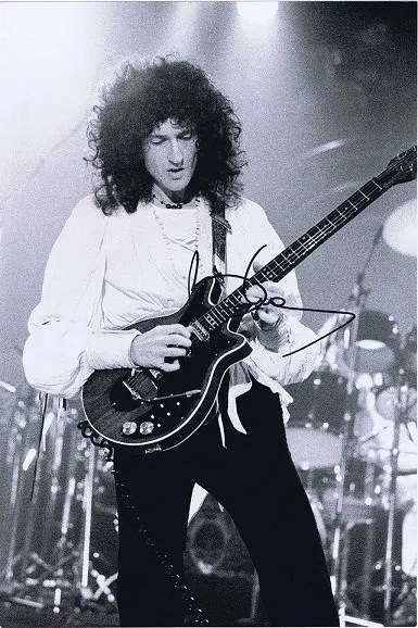 Brian May of Queen Autographed photo 12×8 #2
