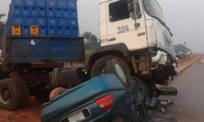 sedan car crushed by a heavy duty vehicle