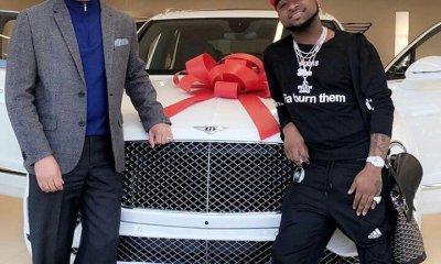 Davido posing with his Bentley Bentyga
