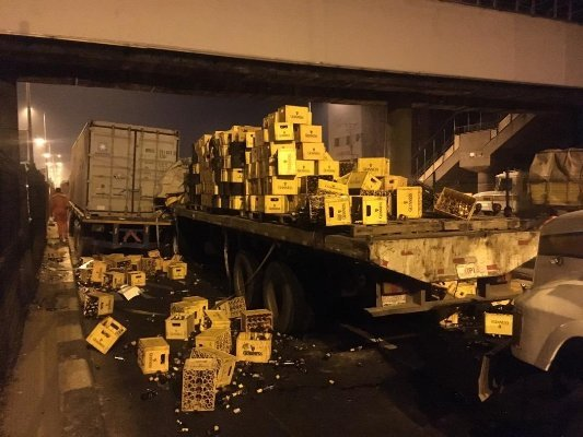 container hit truck