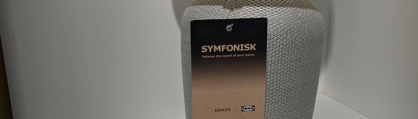 White Ikea Symfonisk Tablelamp Speaker sitting on shelf at Ikea