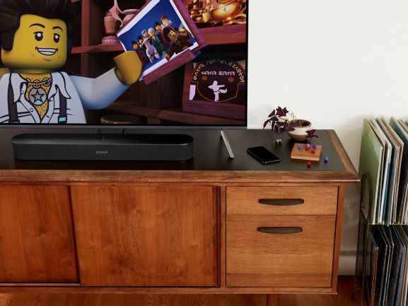 Sonos Beam on Home Entertainment Centre, with Lego Movie playing on TV