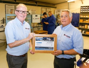 Quick Managing Director Andrew Esson (Left) with Engineering Director Alan Egglestone (right) receive certification from the British Fluid Power Association for the company's Hydraulic training programmes