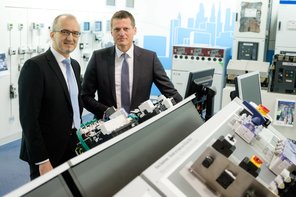 Christof Spiegel (left), Managing Director at Eaton Industries GmbH in Germany, und Wilfried Bauer (right), Head of System Integration, Digital Solutions, Cloud, Internet of Things at T-Systems, work together to ensure future machines are ready for the Internet of Things