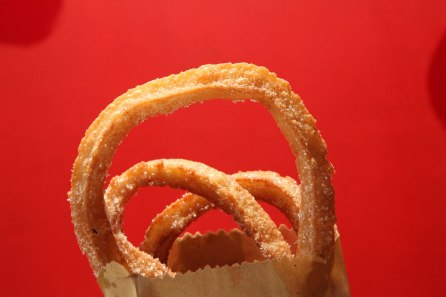 Churros in Colombia are much thinner than in many other Latin American countries. In Bogota they come in thin circles dusted with the obligatory cinnamon and sugar - they are of course delicious. Photo: Alex Washburn