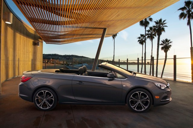 Buick Cascada Convertible, still side image with roof down. Vehicle is shown in Technical Grey exterior color, ebony leather interior and 20-inch wheels.