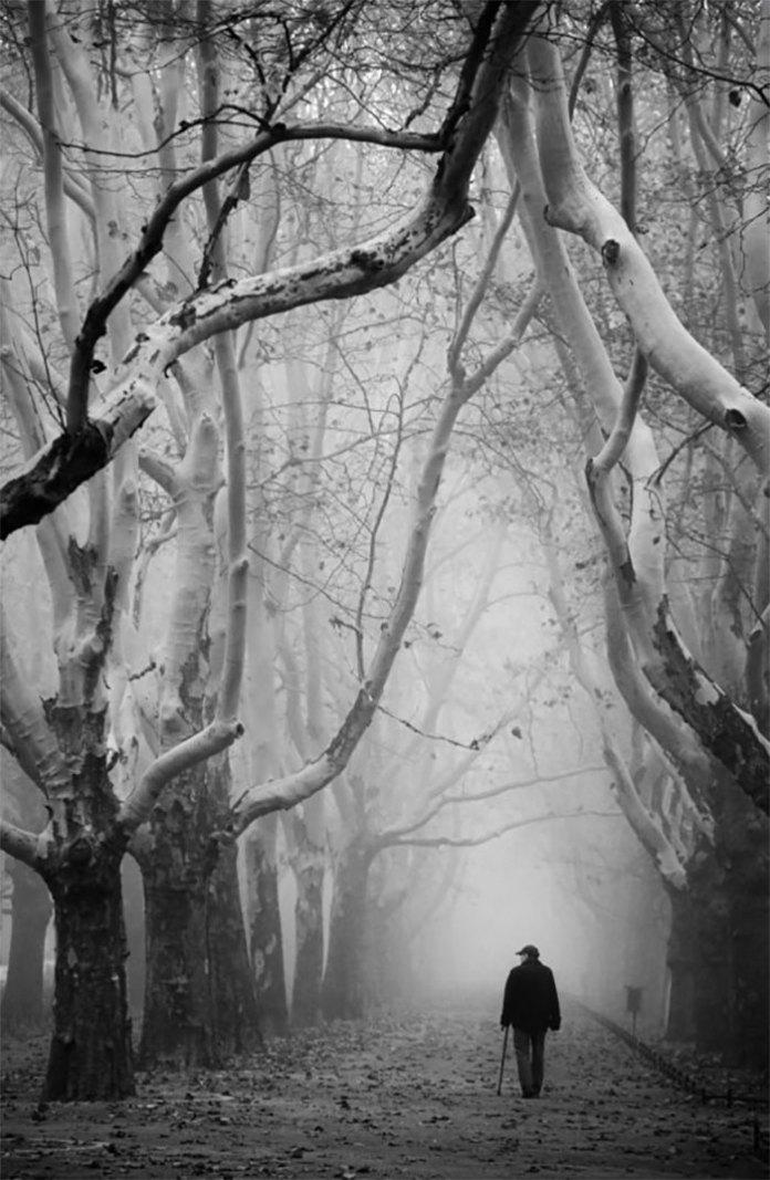 A man is walking alone