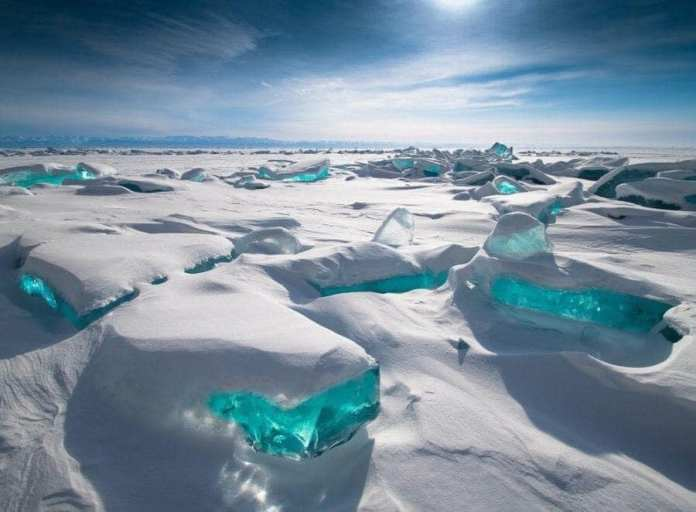 Emerald ice on Lake Baikal located in the southern Russian region of Siberia. (The oldest known lake in the world)
