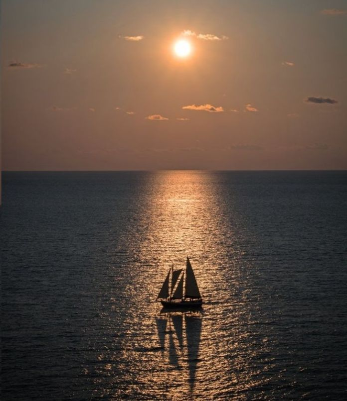 Sail Boat In The Sunset